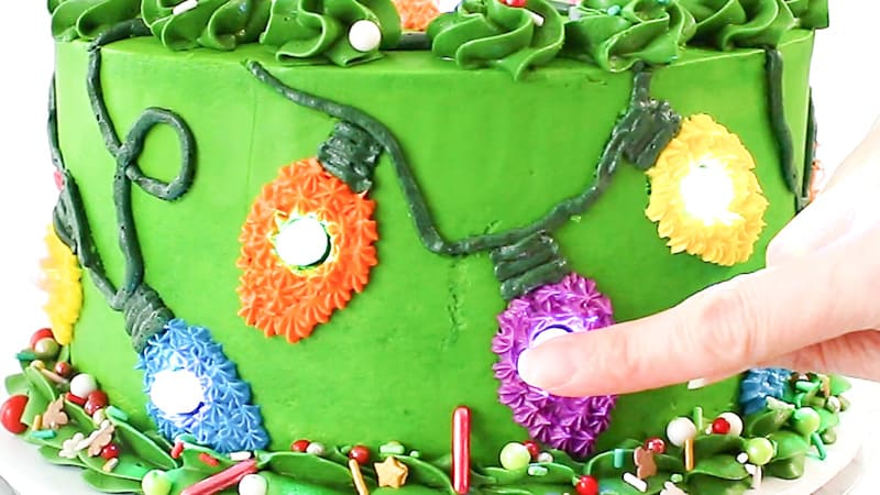 pushing led balloon lights into cake