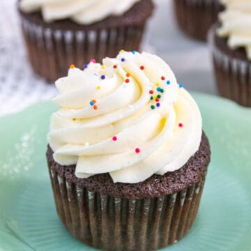 whipped vanilla icing on a cupcake