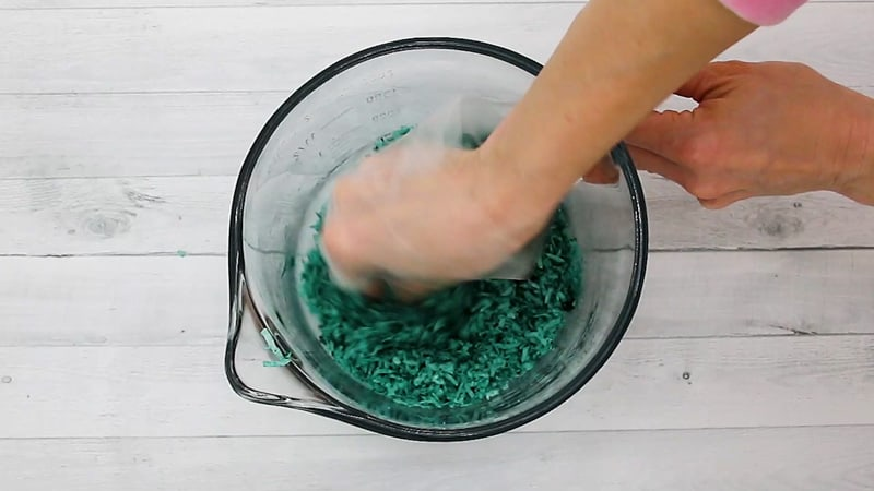 mixing green coconut in a bowl