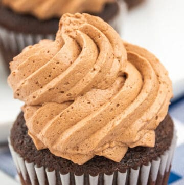 chocolate piped frosting on a cupcake