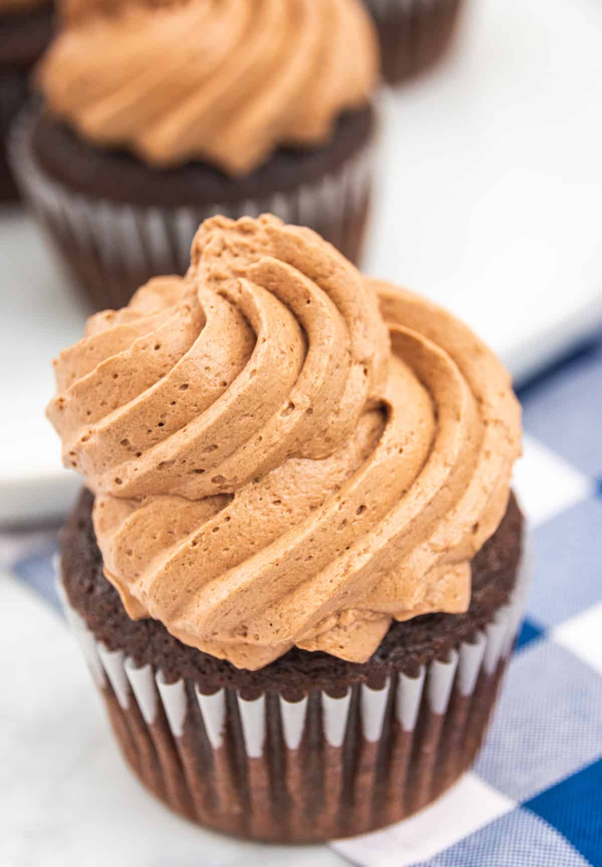 fluffy chocolate frosting on a cupcake