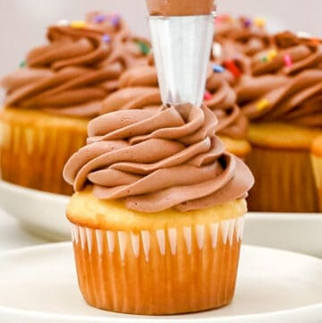 piping icing onto cupcake featured image