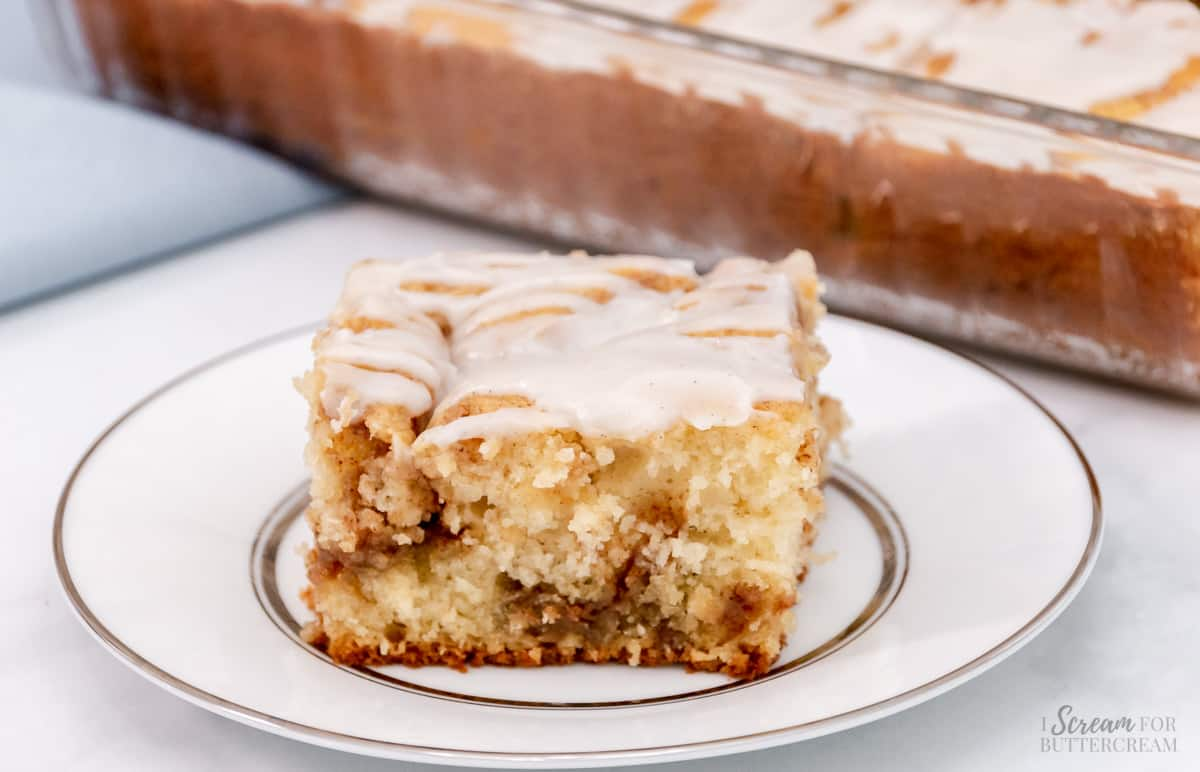 large slice of cinnamon cake on a white plate